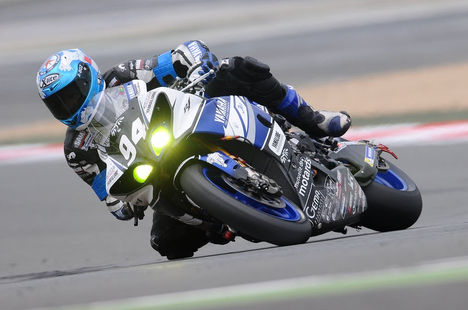 A man riding a motorcycle on a track