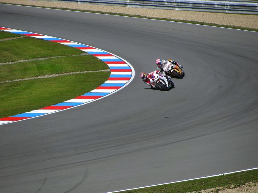 A person riding a motorcycle on a track